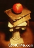 Stock photo  of a pedestal with book and apple