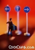 toy person at signs pointing different directions Stock photo