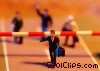 Stock photo  of a toy people at road barrier