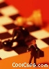 toy person and fallen pawns on a chess board Stock photo