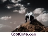 businessman on top of hill head in hands Stock photo