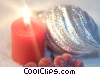 Stock photo  of a candle & Christmas ornaments