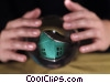 hands and a crystal ball with a house inside Stock photo