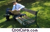man reading the newspaper on a park bench Stock photo