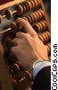 Stock photo  of a hand working with an abacus