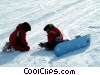 Stock photo  of a snowboarders taking a break