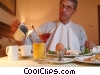 Stock photo  of a businessman eating breakfast