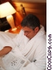man reading the paper in his robe Stock photo