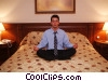 Stock photo  of a Businessman meditating in bed