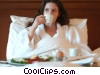 woman having breakfast in her room Stock photo