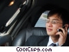 man talking on a cell phone in his limo Stock photo