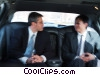 businessmen traveling in a limousine Stock photo