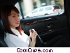 Stock photo  of a businesswoman in a limousine