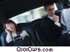 Stock photo  of a business people in a limousine