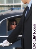 businesswoman getting out of a limousine Stock photo