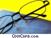 Stock photo  of a eyeglasses with newspaper