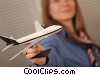 travel agent holding toy airplane Stock photo