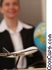 travel agent with model airplane and globe Stock photo