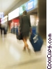 businesswoman walking with her luggage Stock photo