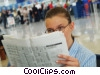 Stock photo  of a woman reading newspaper in
