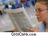 woman reading newspaper in terminal Stock photo