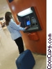 Stock photo  of a woman at bank machine in airport