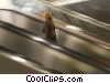 Stock photo  of a woman on a escalator