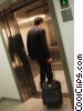 man taking his luggage to his room Stock photo