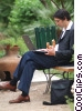 businessman having lunch in the park Stock photo
