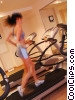 Stock photo  of a woman running on the treadmill