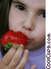 Stock photo  of a girl eating strawberries