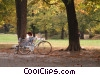 cyclist taking a break in the park Stock photo