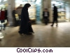 Stock photo  of a woman walking in the mall