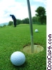 Stock photo  of a golfer practicing putting