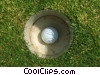 Stock photo  of a golf ball in the cup
