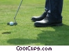 Stock photo  of a golfer lining up his putt