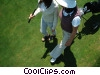 female golfers walking to the next hole Stock photo