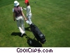 Stock photo  of a female golfers walking to the