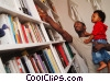 father and son choosing a book to read Stock photo