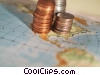 financial concept coins on a map Stock photo