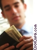 Stock photo  of a man counting his money