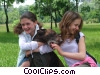 girls playing with their dog Stock photo