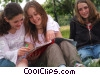 Stock photo  of a girls reading in the park