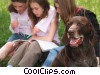 girls reading in the park with their dog Stock photo