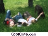 girls playing in the park with their dog Stock photo
