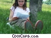 Stock photo  of a girl reading in the park