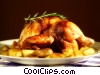 Roast chicken on a bed of new potatoes Stock photo