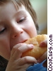 Stock photo  of a Boy eating a pastry for snack