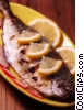Fish dinner served with slices of lemons Stock photo