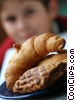 Stock photo  of a Boy with croissants and